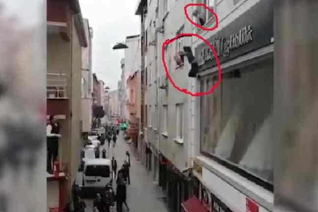 A mother throwing children from the third floor